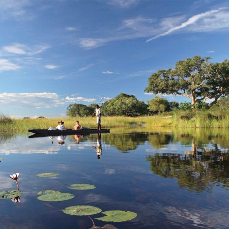 gliding-on-the-okavango-delta-in-a-mokoro-on-a-private-jet-expedition-with-andbeyond-1600x900